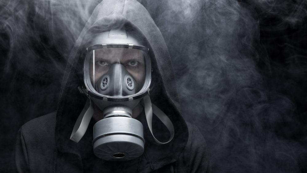 Man in Respirator 283864244 scaled e1609961460378